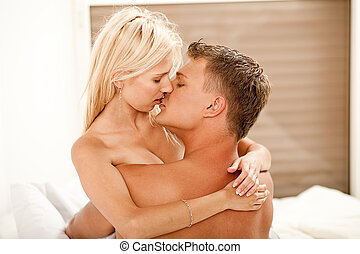 Young kissing couple - Guy and lady kissing and embracing...