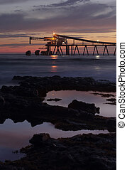 Mining - Blue metal gravel loader at dawn Bass Point - The...