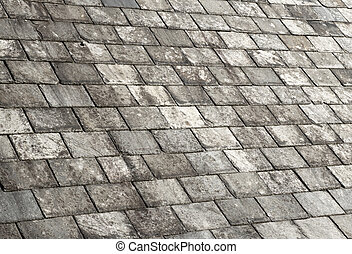 Old weathered gray slate tiles roof.