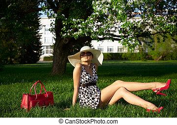 girls in the garden - tanned girl on grass in the garden