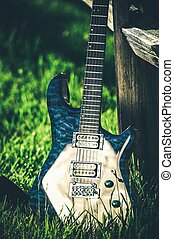 Modern Electric Guitar at Countryside Place Wooden Fence and...