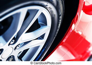 Modern Car Wheel Closeup - Modern Red Car Body Alloy Wheel...