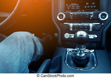 Stick Shift Driver. Driver in the Modern Compact Car with...
