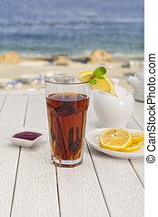 tea with lemon and cinnamon on the beach