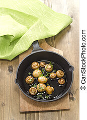 grilled mushrooms in a cast iron pan - grilled mushrooms...
