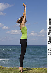 fitness on the beach - woman on the beach doing fitness...