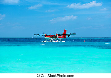 Twin otter seaplane at Maldives - Twin otter red seaplane at...
