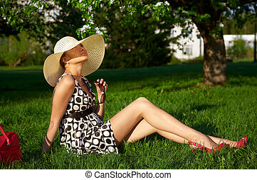 girls in the garden - tanned girl on grass in the garden