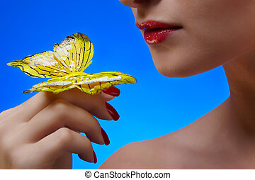 Girl with buterfly - close-up of lower part of beautiful...