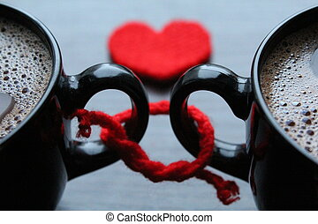 Two cups of coffee and red heart on the background - Two...
