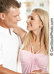 Leisure time - Young caucasian couple looking at each other