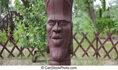 wooden statue of ancient god - wooden statue of the ancient...