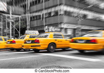 Zoomed and blurred view of New York yellow cabs isolated on blac