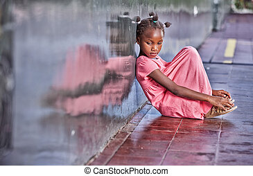 Sad african girl sitting and deeply thinking on the school...