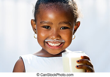 Cute african girl showing white milk mustache. - Close up...
