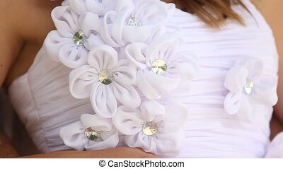 wedding dress decorated with flowers and beads