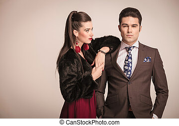 Elegant fashion couple posing - Handome young business man...