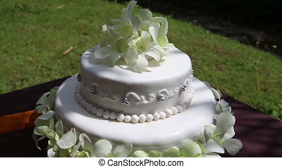 wedding cake decorated with orchid and bead rotate - rotate...