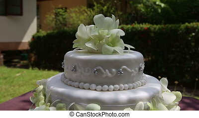 wedding cake decorated with orchid and bead - zoom on fresh...