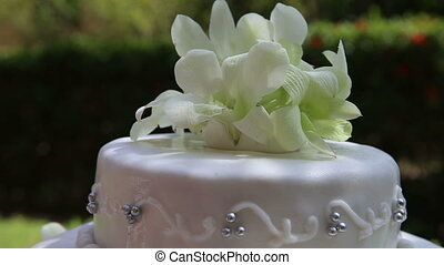 wedding cake decorated with orchid and bead - rotating...
