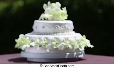 wedding cake decorated with orchid and bead - focusing on...