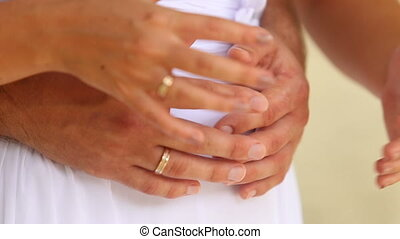 groom and bride arms with wedding rings - groom and bride...