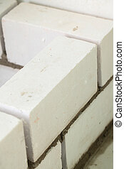 Brickwork - Building a white brick wall