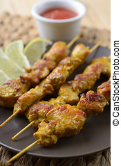 Satay - Chicken satay with slices of lime and sauce