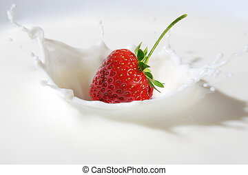 Delicious strawberry splashing into milk