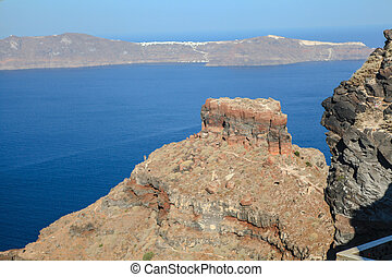 Skaros rock in Santorini against blue sea as a background -...