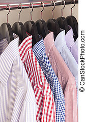 variety of shirts on hangers