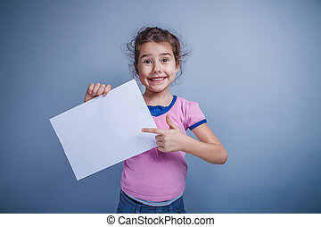 girl child 6 years of European appearance holds a clean sheet, s