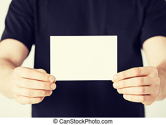 man hand with blank paper - picture of man hand with blank...