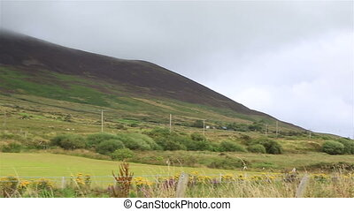 Clouds lie on the mountains Ring of Kerry in Ireland