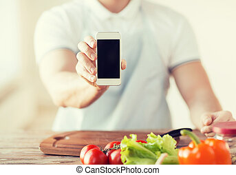 close up of male hands holding smartphone - cooking,...