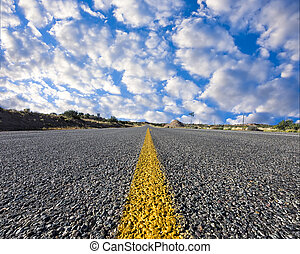 Desert Road to Nowhere - Street-level view of a desolate...