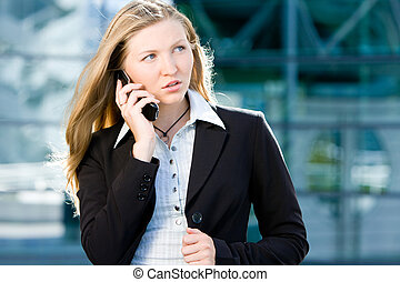 Blonde business woman on mobile phone