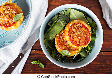 Macaroni and cheese in muffin tins with tomatoes