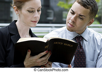 Business People and The Bible - Two Christian coworkers...