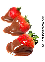 Chocolate strawberries - Three chocolate coated stawberries...
