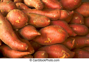 pile of garnet yams at the farmers market