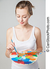 artist woman with paint palette. Isolated.