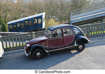 Old automobile tuning against funicular in spring park -...