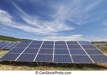 solar energy field - solar field with cloudy sky