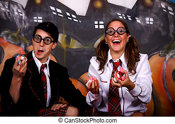 Halloween students sweets - Young Halloween couple, female...