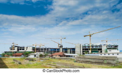 Cranes Working In Construction Site