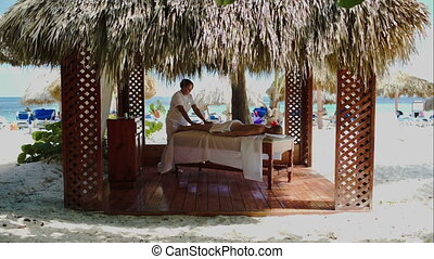 Spa treatment massage in gazebo on the beach - Massage...