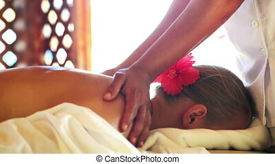 Woman getting back and shoulder girdle massage
