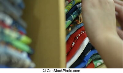 Woman looking over the pile of materials in shop - Close-up...
