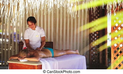 Spa treatment massage in gazebo - Masseur providing spa...